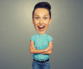 Amazed woman with big head over grey background Royalty Free Stock Photography