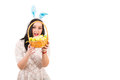 Amazed woman looking in easter basket into with eggs copy space for text message right part of image Royalty Free Stock Images
