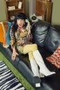 Amazed woman on phone pretty sofa holding telephone Stock Images