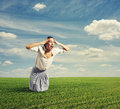 Amazed woman standing on the road and screaming Royalty Free Stock Images