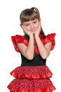 Amazed young girl in a red polka dot dress Stock Photos