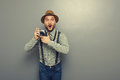 Amazed young man with camera Royalty Free Stock Photo