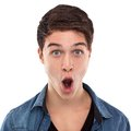 Amazed young man with open mouth and large eyes Stock Images