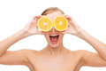 Amazed young woman with orange slices health nutrition and beauty concept clean face of beautiful Royalty Free Stock Photo