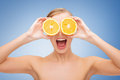 Amazed young woman with orange slices health nutrition and beauty concept clean face of beautiful Royalty Free Stock Images