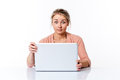 Amazed young woman sitting at clean desk staring at computer Royalty Free Stock Photo