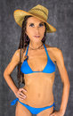 Amazement straw hat sexy latin girl with african braids in a dressed in blue bikini Royalty Free Stock Photo