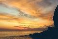 Amazing beautiful sunset on the seashore near the rocks with dramatic sky Royalty Free Stock Photo