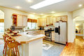 Amazing bright kitchen with maple cabinets Royalty Free Stock Images