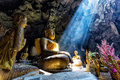 Amazing Buddhism with the ray of light in the cave Royalty Free Stock Photo
