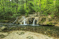 Amazing cascades and clear river in forest beusnita national park romania beautiful waterfalls babbling brook Royalty Free Stock Photography
