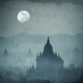 Amazing castle silhouette under moon at mysterious night fantasy grunge background in vintage style Stock Photos
