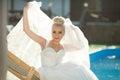 Amazing elegance cute stilysh blonde bride is posing on the bac Royalty Free Stock Photo