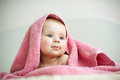 Amazing girl in pink towel on bed Royalty Free Stock Image