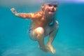 Amazing happy baby boy dives underwater Stock Photo