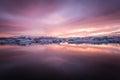 Amazing iceland sunset over the icebergs of the jokulsarlon glacier lagoon long exposure and vanilla tones Stock Photo