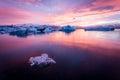 Amazing iceland sunset over the icebergs of the jokulsarlon glacier lagoon long exposure and vanilla tones ice chunk on foreground Royalty Free Stock Photos