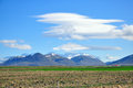 Amazing icelandic landscape mountains field clouds Stock Photography