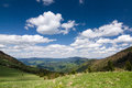 Amazing spring mountain landscape with blue sky and clouds