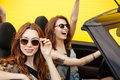 Amazing two young women friends sitting in car Royalty Free Stock Photo
