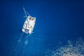 Amazing view to catamaran cruising in open sea at windy day drone view birds eye angle Royalty Free Stock Photo