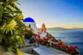 Amazing view with white houses in Oia village. Royalty Free Stock Photo