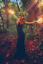 Amazing young witch casts a spell in the woods outdoors Royalty Free Stock Photos
