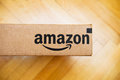 Amazon box seen from above paris france jan logotype printed on cardboard side on a wooden floor inc is the an american Stock Photos