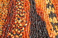 Amber beads of different colors various for sale on lithuanian market Stock Image