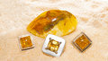 Amber cabochons set in jewllery jewellery together with a polished nodule of the fossilized resin of ancient trees that often Royalty Free Stock Image