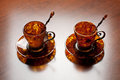 Amber cofee set coffee with silver spoons photographed on wooden surface Stock Image