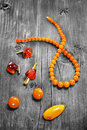 Amber jewelery on black and white vintage wooden background Stock Photos