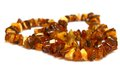 Amber necklace a close up look on a Royalty Free Stock Photos