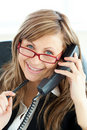 Ambitious businesswoman talking on phone smiling Stock Photo