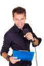 Ambitious male leader speaking on microphone with notes Royalty Free Stock Photography