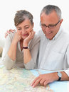 Ambitious older couple planing their travel Stock Photos