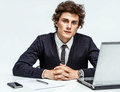 Ambitious young businessman looking at camera