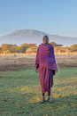 Amboseli kenya september young masai man and kilimanjaro mountain at backdrop on in national park Stock Photo