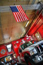 Ambulance american flag fire department in a garage with an Royalty Free Stock Images