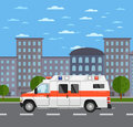 Ambulance car on road in urban landscape Royalty Free Stock Photo