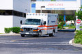 Ambulance leaving hospital after emergency Stock Photos