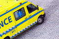 Ambulance top view of a yellow includes detailed clipping paths for the word and both emergency numbers and including Stock Photos