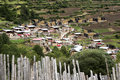 Amdo farmers traditional village typical in the foothills of tibet barley and corn dryer wood fence Stock Photo