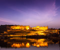 Amer fort amber fort at night in twilight jaipur rajastan illuminated one of principal attractions india refelcting maota lake Stock Image