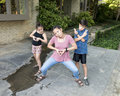 Amerasian siblings strike a pose Royalty Free Stock Photo