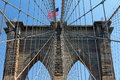 America Flag Flying Over The Brooklyn Bridge Royalty Free Stock Image