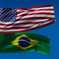 American and brazilian national flags waving upon blue sky Royalty Free Stock Photography