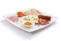 American breakfast on white plate isolated Royalty Free Stock Image