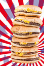 American burgers a very tall pile of cheesburgers representing gluttony or a very special fast food offer Stock Photography