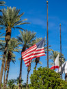 American and Californian flags flying at half mast Royalty Free Stock Photo